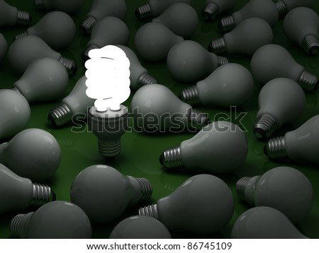 It's time for energy saving light bulb, one glowing compact fluorescent light bulb standing out from the dim incandescent bulbs on green - stock photo