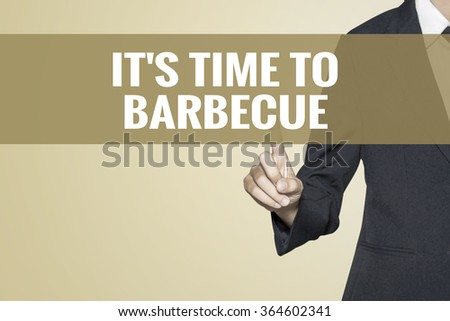 It's Time to Barbecue word on vintage background retro virtual screen touch by business woman on white background - stock photo