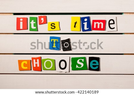 It's time to choose - written with color magazine letter clippings on wooden board. Concept  image - stock photo