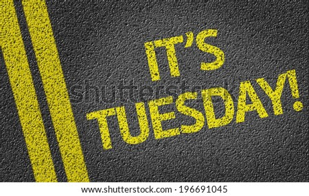 It's Tuesday! written on the road - stock photo