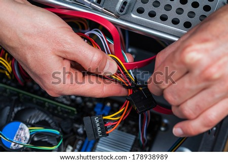 IT specialist repair the computer - stock photo
