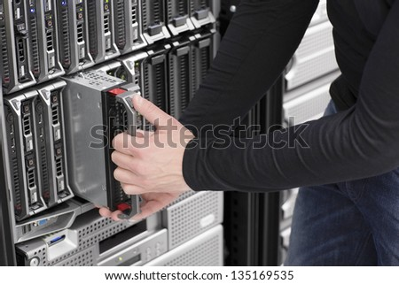 IT technician / engineer install / removes / replace a blade server in a data center.