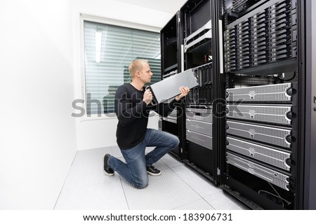It technician replace blade server in datacenter - stock photo