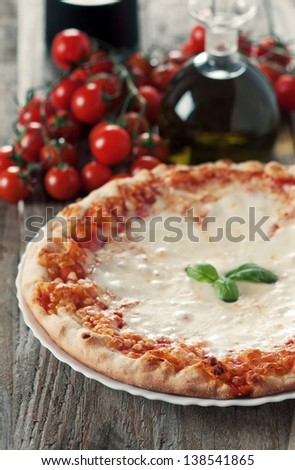Itaditional pizza with mozzarella and basil, selective focus and retro style - stock photo