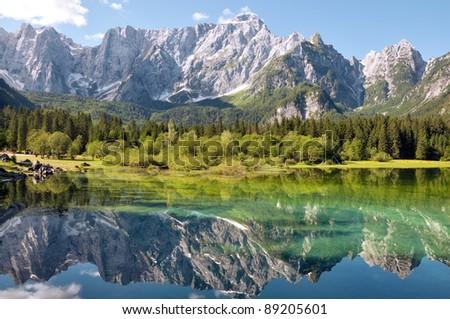 Italia - Udine - Lago di Fusine and monte Mangart reflex on lake - stock photo