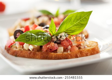 Italian Appetizer Bruschetta with Tomatoes, Cheese and Basil - stock photo