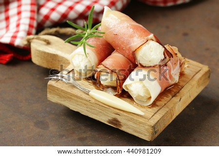 Italian appetizer soft cheese wrapped in parma ham - stock photo