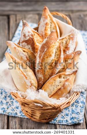 Italian bread/buns Ciriola Romana. Buns in the basket - stock photo