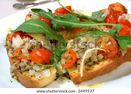 Italian bruchetta with halved cherry tomatoes - stock photo