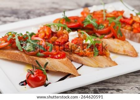 Italian Bruschetta Appetizer on the white plate - stock photo