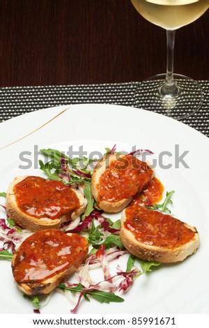 italian bruschetta seasoned with tomato and lettuce - stock photo