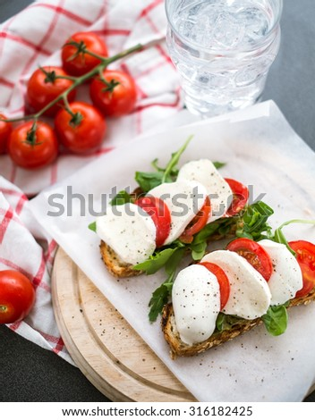 Italian bruschetta with mozzarella and tomatoes - stock photo