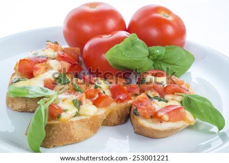 italian bruschetta with tomato basil and mozzarella - stock photo
