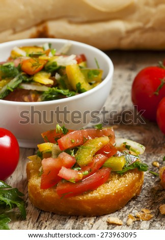 Italian bruschetta with tomato, onion and bell petsem, selective focus - stock photo