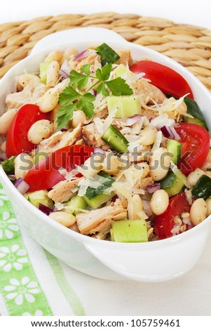 Italian cannelini bean and tuna salad, with cucumber, tomato, red onion, parmesan cheese and a garlic vinaigrette dressing.