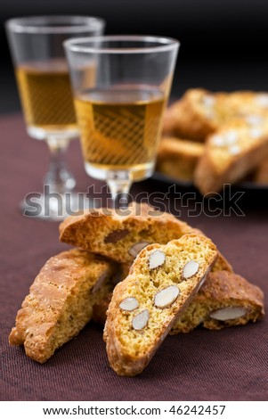 Italian cantucci and two glasses of wine - stock photo
