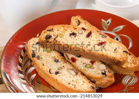 Italian cantucci ir red saucer. - stock photo