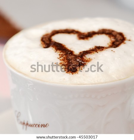 Italian cappuccino with choccolate heart. Shallow depth of field. Very high resolution (can be cropped). - stock photo