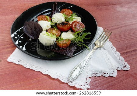 Italian caprese salad with fresh basil leaves, tomato and  mozzarella  on red wooden table. Overhead view. From series Natural organic food - stock photo