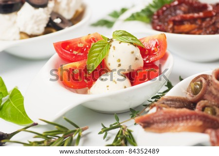 Italian caprese salad with tomato, mozzarella cheese and basil