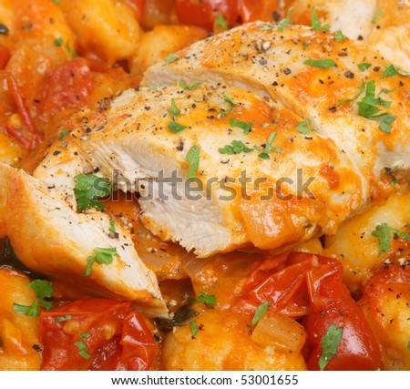 Italian casseroled chicken breast with gnocchi pasta and cherry tomatoes - stock photo