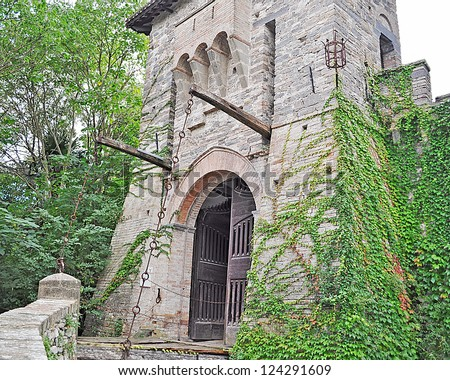 italian castle drawbridge surrounded by vegetation