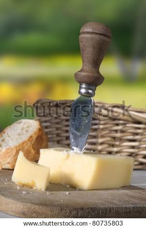 Italian cheese, parmigiano reggiano with special knife - stock photo