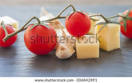 Italian cheese with tomato and garlic