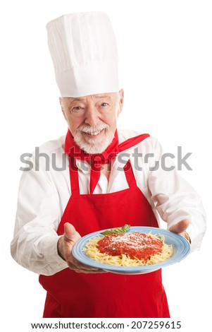 Italian chef holding a plate of spaghetti marinara over white background.