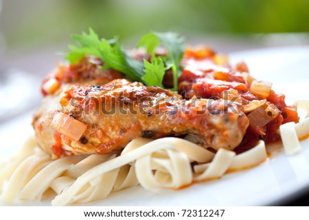 Italian chicken cacciatore served with pasta - stock photo