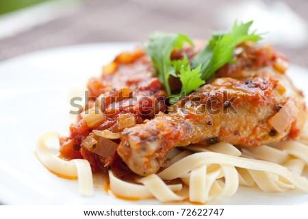 Italian chicken cacciatore served with pasta - stock photo