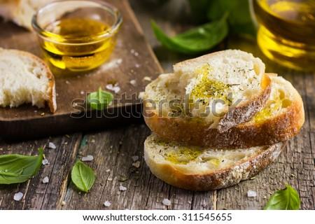 Italian ciabatta  bread with olive oil, selective focus - stock photo