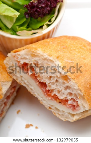 Italian ciabatta panini sandwich with parma ham and tomato