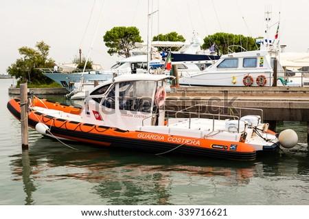 italian coast guard boat in grado harbor, 17. september 2015 - stock photo