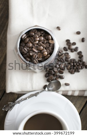 Italian coffe maker pot filled with coffee beans, from above - stock photo