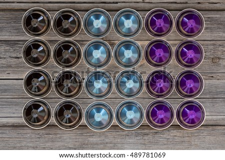 Italian coffee espresso capsules or coffee pods on wood vintage background