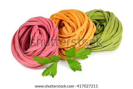 Italian colored fresh rolled fettuccine pasta with parsley isolated on white background. - stock photo