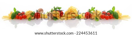 Italian cooking and ingredients banner on a reflective white surface with a line of with dried pasta or noodles, tomato, basil and fresh herbs in a decorative arrangement - stock photo
