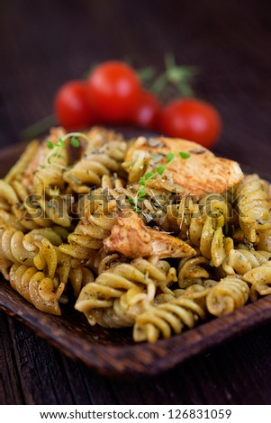 Italian cooking. Fusilli pasta with pesto basil sauce and chicken - stock photo