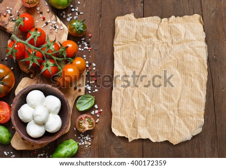 Italian cooking ingredients : mozzarella, tomatoes, basil, olive oil and other - stock photo