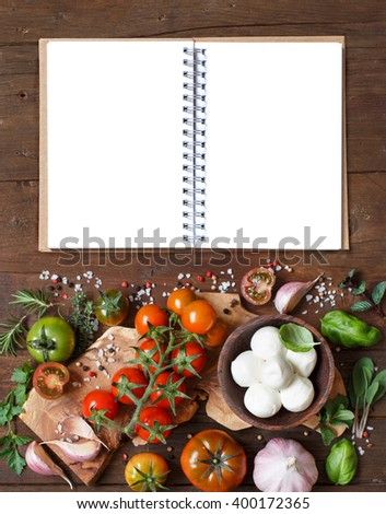 Italian cooking ingredients: mozzarella, tomatoes, garlic, herbs  and other - stock photo