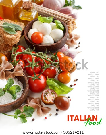 Italian cooking ingredients : mozzarella, tomatoes, garlic, herbs,  olive oil and other - stock photo