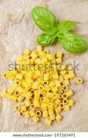 Italian cooking ingredients, pasta,fresh  basil leaf on white background - stock photo
