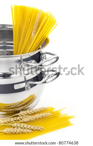 Italian cooking / saucepan with pasta / isolated on white - stock photo