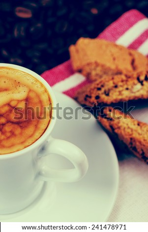 italian creamy espresso with cantuccini biscuits - stock photo