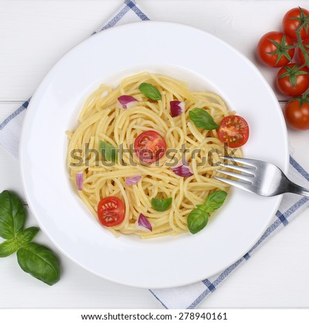 Italian cuisine spaghetti with basil and tomatoes noodles pasta meal from above on a plate - stock photo