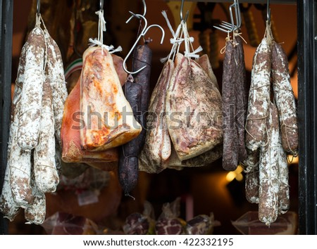 Italian different traditional sausages and ham  at the store. - stock photo