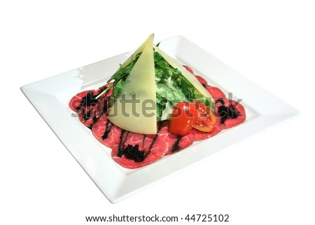 Italian dish: carpaccio of beef marble with black caviar, lettuce, tomatoes and parmesan slices. Isolated on white.