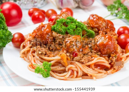 Italian dish spaghetti bolognese with beef meatballs and parsley - stock photo