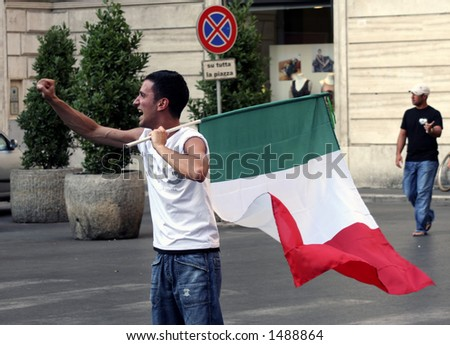 Italian fan is celebrating with the Italian flag after Italy won a game in the world cup championship - stock photo